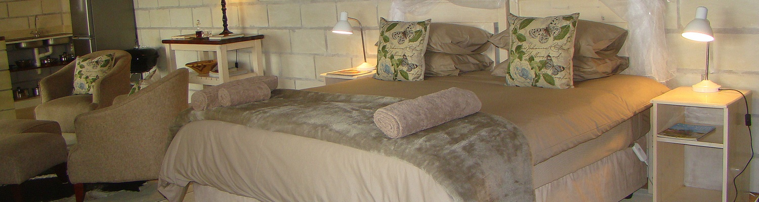 The beautiful king size bed with heated blankets and bi cuddly duvets in Quail Self Catering Cottage, one of the SkyWind Cottages at Amohela ho Spitskop Country Retreat Between Ficksburg and Clocolan Free State