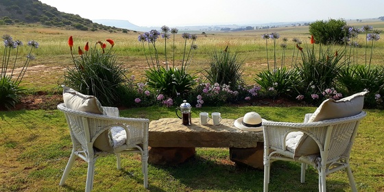 Guinea Fowl Self Catering Cottage with two bedrooms en suite, big open plan living area with huge open fire.