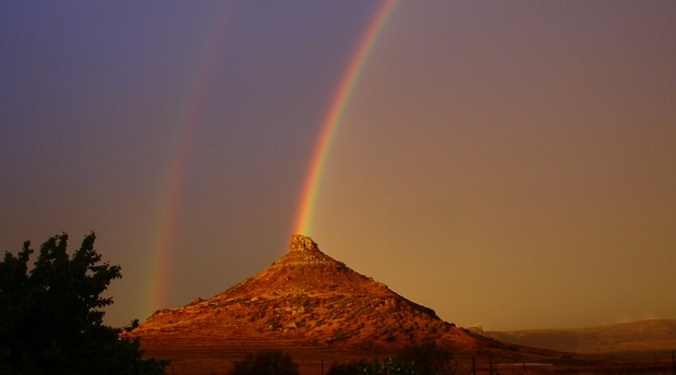 A double rainbow over Spitskop Mountain, at Amohela ho Spitskop Country Retreat & Conservancy on the border  of Ficksburg & Clocolan Free State.