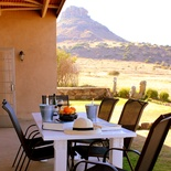 Mongoose Self Catering Cottage on the Clocolan Ficksburg border Eastern Free State, dining Al Fresco with the view of the mountain behind.