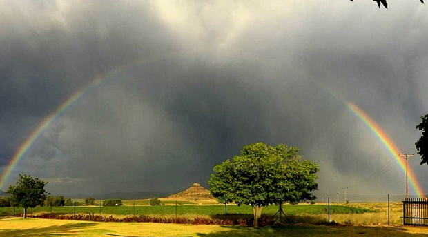 A rainbow covers Amohela ho Spitskop Country Retreat & Conservancy between Ficksburg & Clocolan in the Eastern Free State